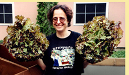 Hilary holding two heads of organic lettuce